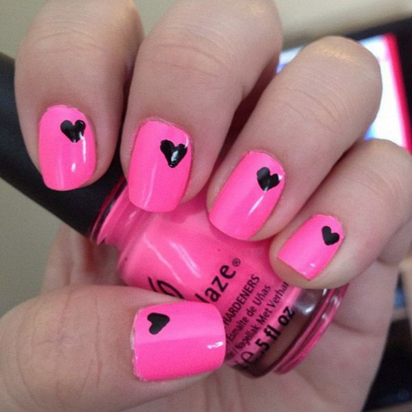 Pink Nail with Small Black Hearts on Top.