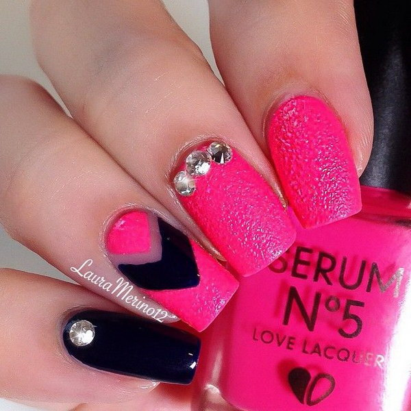 Pink and Black Studded Nail Design.