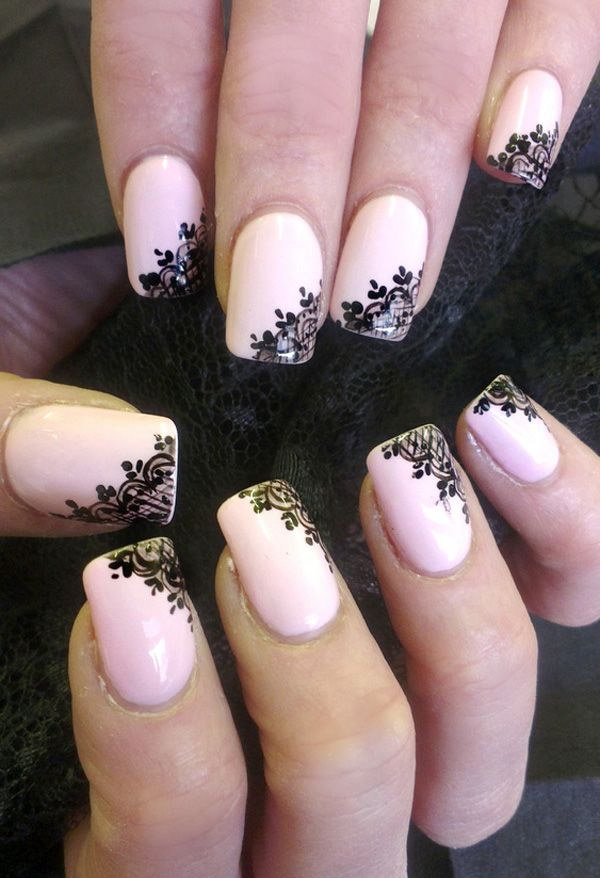 Light Pink Nails with Balck Flowers Accented.