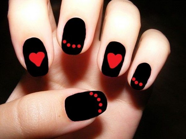 red and black nail design with hearts and dots