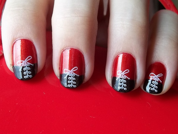 White Shoelace on Black and Red Nails.