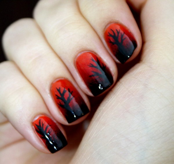 Black Trees on Red Base Nail Design.