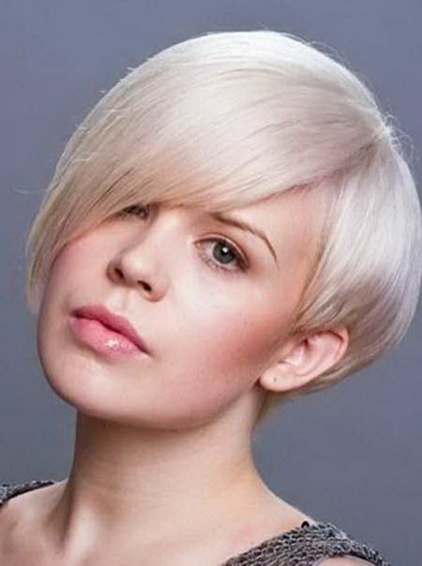 Pixie Haircut with Fantastic Side swept Bangs and Short Layered Sides for Round Faces.