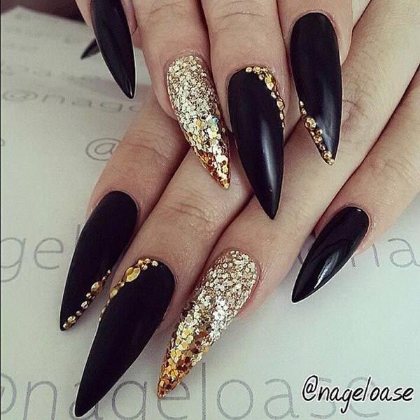 Black & Gold Stiletto Nail Design.