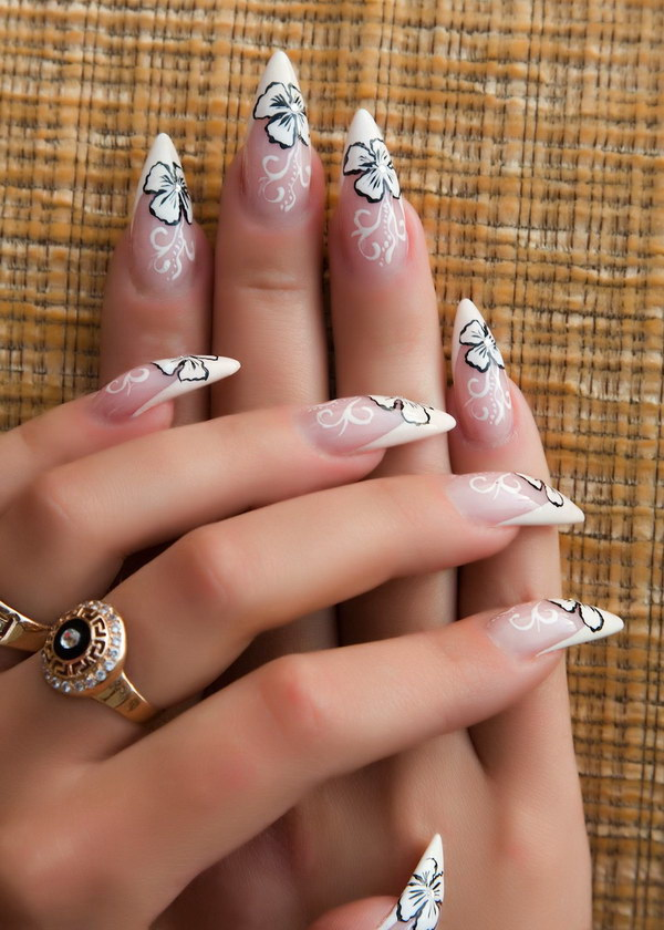White Orchids with Black Outline Stiletto Nails.