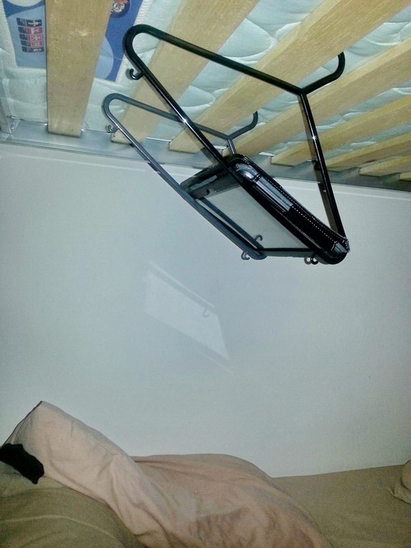 Suspend your tablet over your bed with coat hangers.