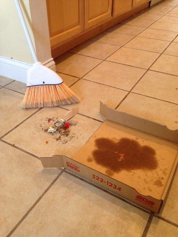 If there is no dustpan in your dorm room, use a Pizza box to serve as a DIY dustpan.