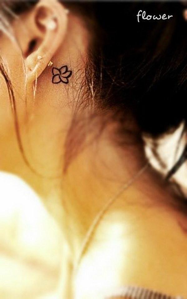 Tiny Floral Ear Tattoo Design.