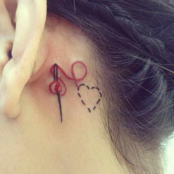 Heart Thread and Needle Ear Tattoo.