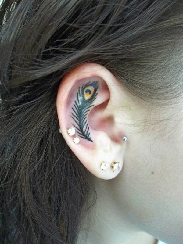 Peacock Feather Tattoo in Ear.