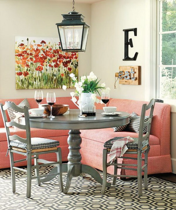Stylish Breakfast Nook with Red Banquette Seating.