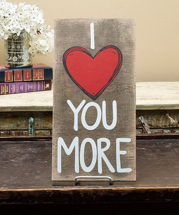 'I Love You More' Wall Plaque.