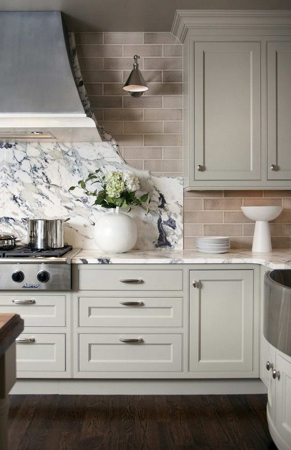 Marble Slab and Subway Tile Backsplash with Light Grey Kitchen Cabinets