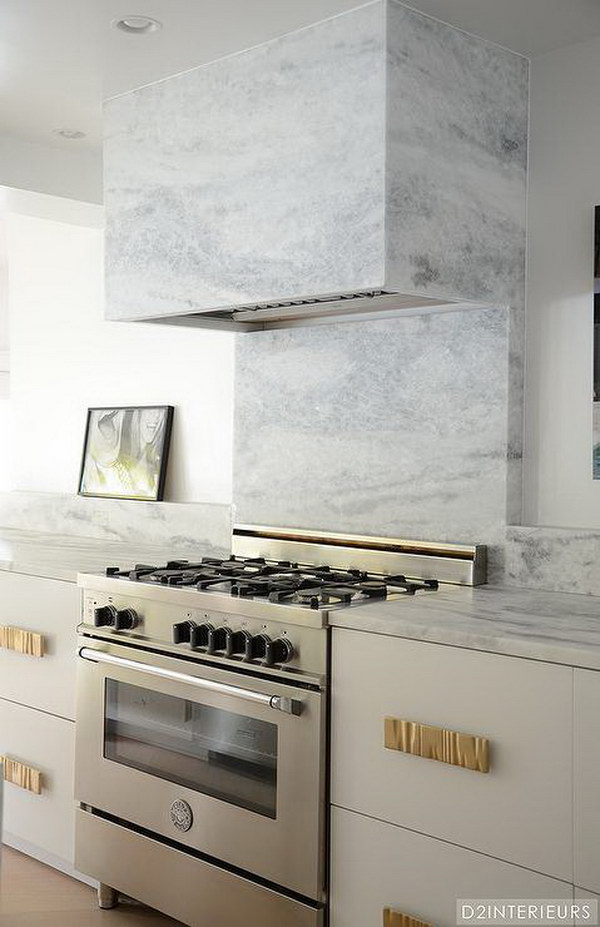 marble backsplash. gray and white and marble kitchen reveal. white