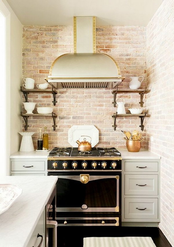 Eclectic Blue Kitchen with Exposed Brick Backsplash