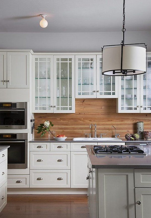 rustic and warm white kitchen with natural wood backsplash