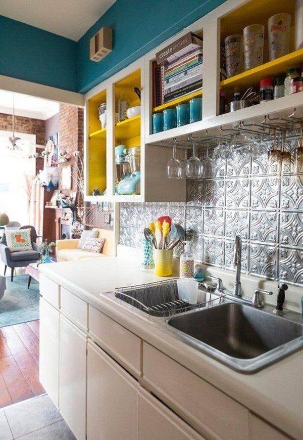 Bright Painted Cabinets and Tin Ceiling Style Backsplash