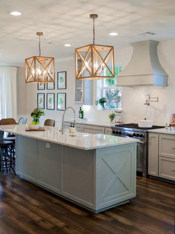 Modern White Kitchen with Wooden Pendants.