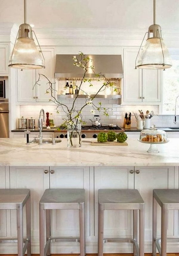 Crisp White Kitchen with A Pair of Glass Pendant Lignts.