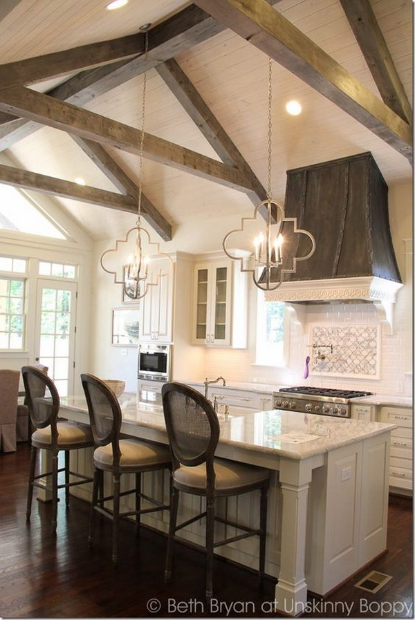 Gorgeous Lighting Under Wood Ceiling Beams.