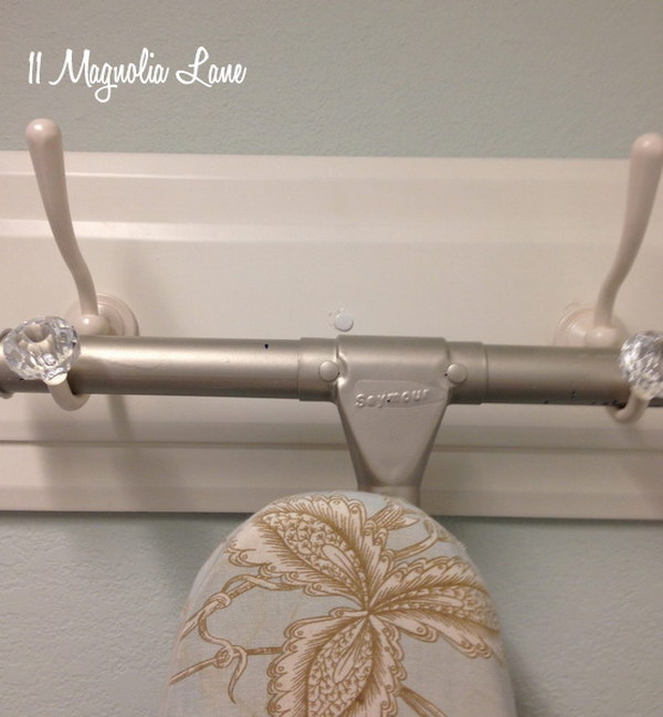 Get The Iron Board Off The Floor With Two Decorative Hooks