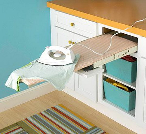 Add a Pull Out Ironing Board In The Laundry Cabinet