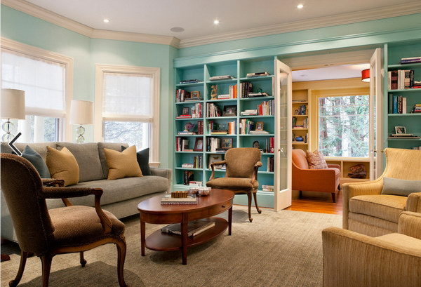 Blue Painting Living Room with Bookshelf.