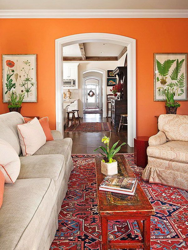 Bold Orange Wall Painting With White Trim.