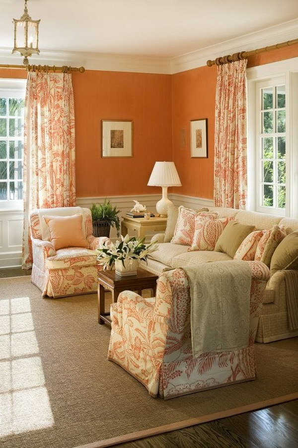 Living Room With Orange Wall, Chairs and Curtains.