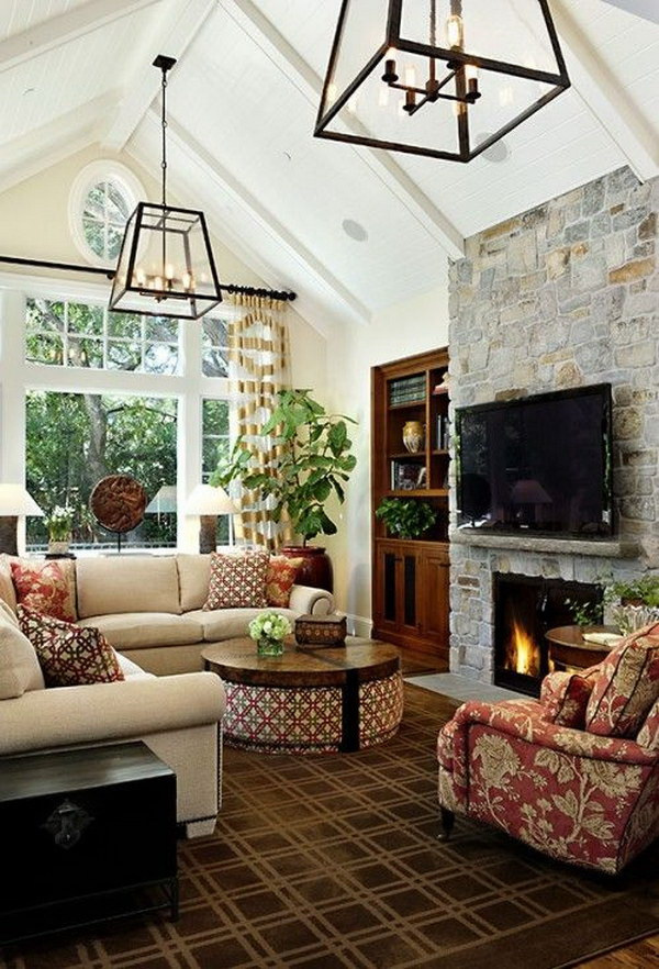 Windows, light fixtures, and stone fireplace