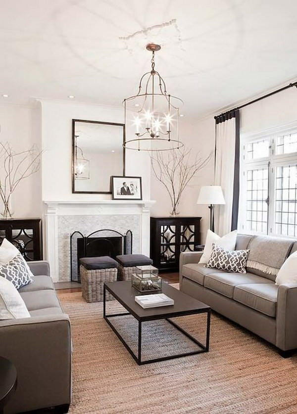 Soothing Monochromatic Grey Living Room with A Stunning Chandelier.