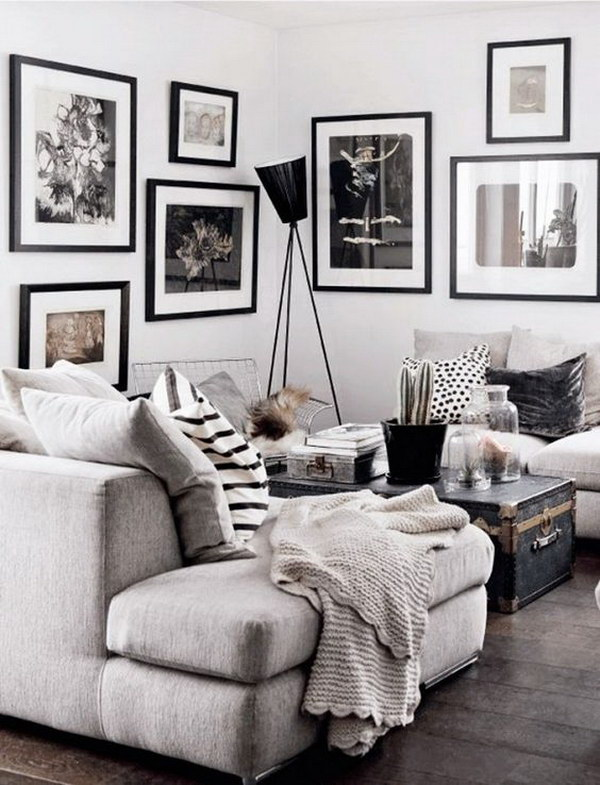 Black white and gray living room with throw pillows and gallery wall of art