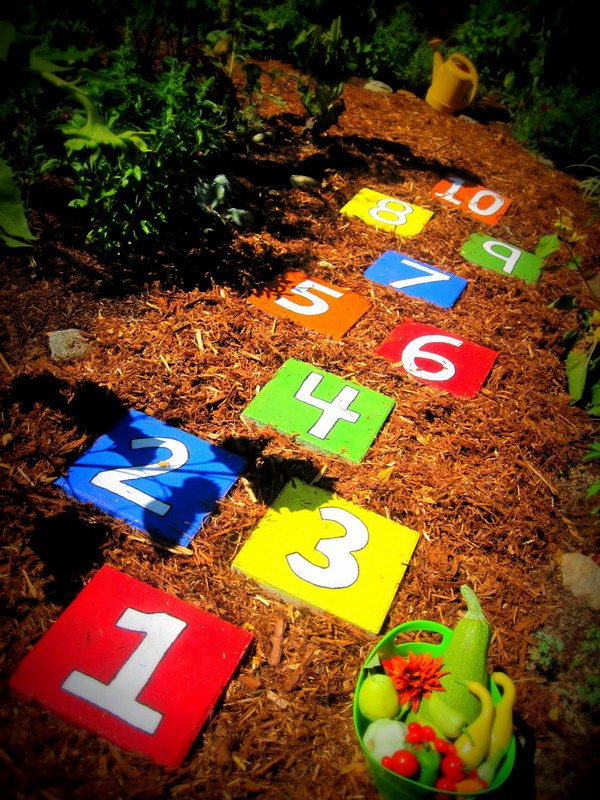 Painted Stepping Stones In Backyard For Hopscotch Game.