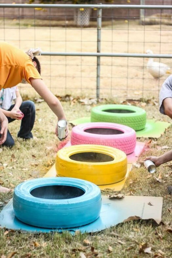 Colorful Painted Tires Into Chicken Baths.