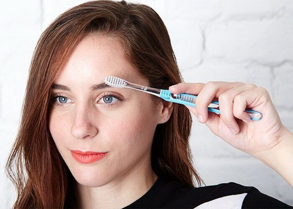 Tame Unruly Brows with Toothbrush.