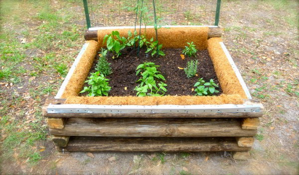 DIY Raised Garden Bed With Weed Cloth And Coconut Fiber To Line The Inside Of The Box.