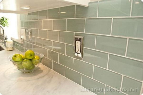 Soft Turquoise Glass Subway Tile against the Carrera Marble Countertops