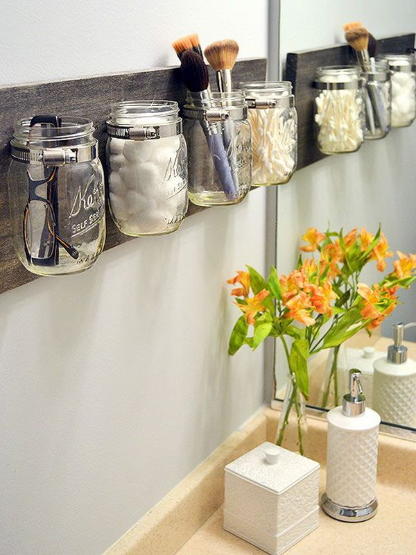 DIY Rustic Mason Jar Rack Used As Makeup Organizers.