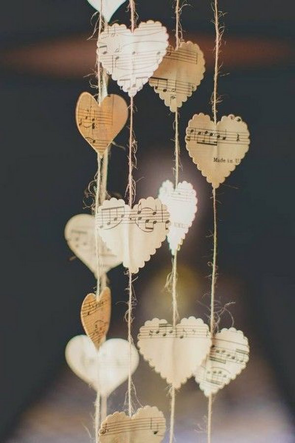 Simple Paper Hanging Hearts Cut From Sheet Music.