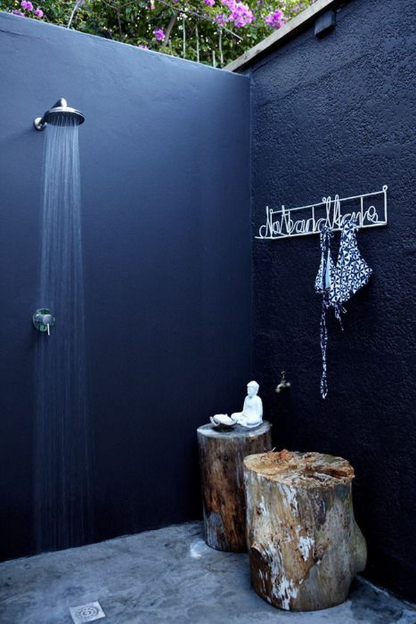 Cool And Relaxing Outdoor Shower with Tree Stump Stools.