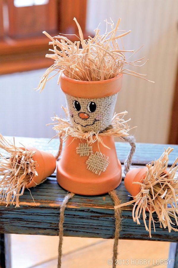 Turn Flower Pots Into Scarecrows .