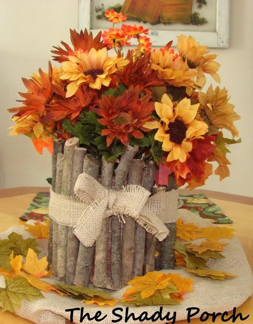 Tree Branch Vase with Sunflower Arrangement.