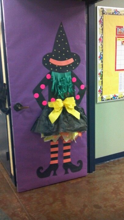 Halloween Door Decorated With A Witch.