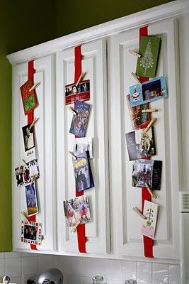 Attach Ribbon to Kitchen Cabinets and Use Clothespins to Hang Cards.