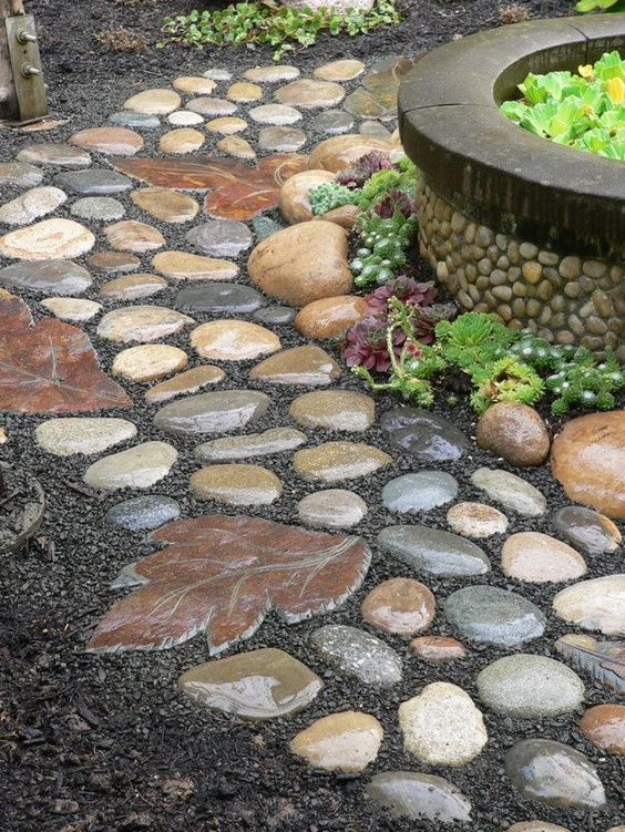 Garden Pathway Made of Rocks and the Stepping Stone Made from a Leaf Mold.