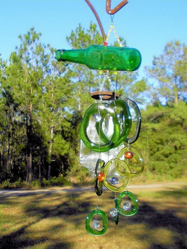 DIY Wind Chime Made of Empty Green Glass Bottles.