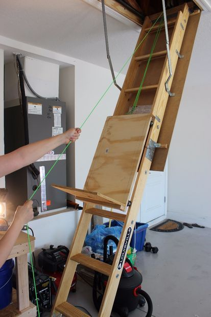 Make a Attic Storage Assistance by Using a Pulley System to Help Loadupthe Attic Ladder.