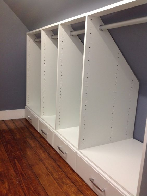 Build a Built In Closet with Hanging Rods and Storage on Bottom.