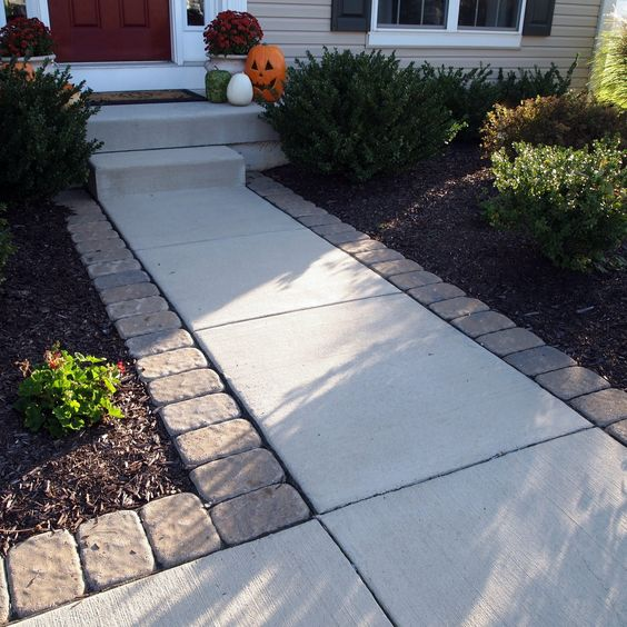 Dress up a Standard Entry by Lining Pavers along the Walkway.