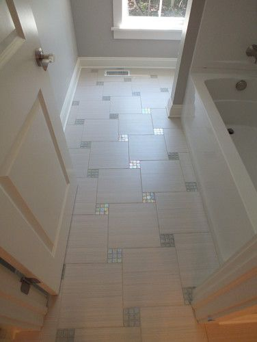 Bathroom Floor With Mosaic Inlays.